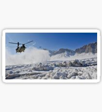 Snow flies up as a U.S. Army CH-47 Chinook prepares to land. Sticker
