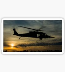 A U.S. Army UH-60 Black Hawk leaves the drop zone. Sticker