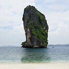 Big rock blue ocean near tropical white sand beach. by Eduard Todikromo
