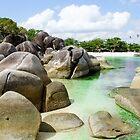 Rocks on coast of beach in Belitung Island. by Eduard Todikromo
