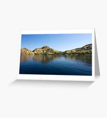 Coastline of mountains reflected  in blue ocean. Greeting Card