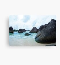 Black rocks on the seashore in Belitung Island. Canvas Print