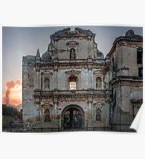 Facade of a ruined Church in Antigua, Guatemala with El Fuego volcano in the background. Poster