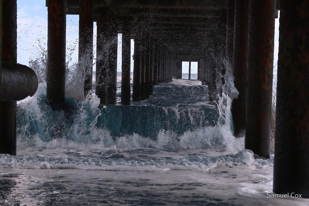sea under pier by Samuel Cox