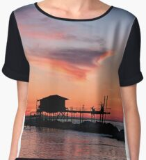 Stilt house in silhouette over the sea Chiffon Top