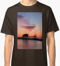 Stilt house in silhouette over the sea Classic T-Shirt