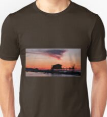Stilt house in silhouette over the sea T-Shirt