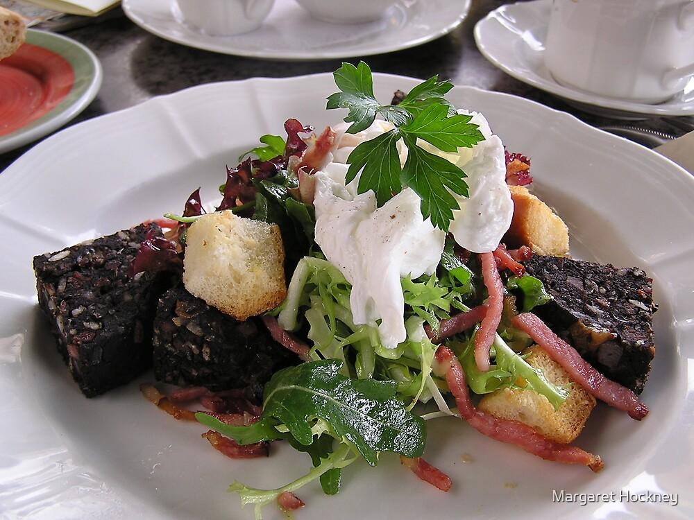 Black pudding salad with poached egg. by Margaret Hockney