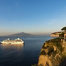 Sunset Postcard from Sorrento - the Sea, the Cliffs and Vesuvius Volcano Behind the Criuse Ship by Georgia Mizuleva