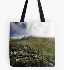 Fog rolls over the hill Tote Bag