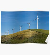 Row of wind turbines on hill Poster