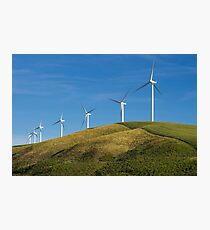 Row of wind turbines on hill Photographic Print
