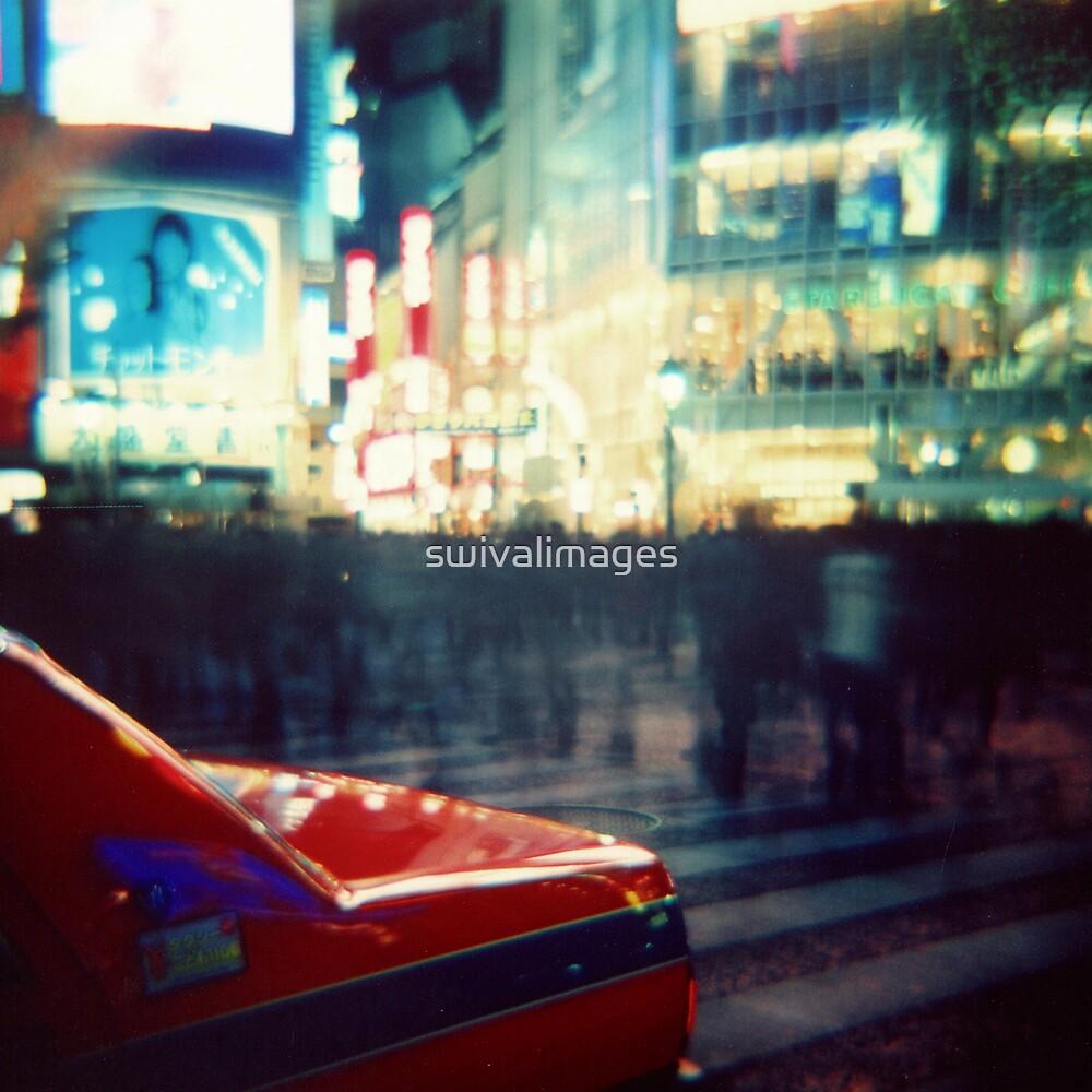 Shibuya at Night by swivalimages