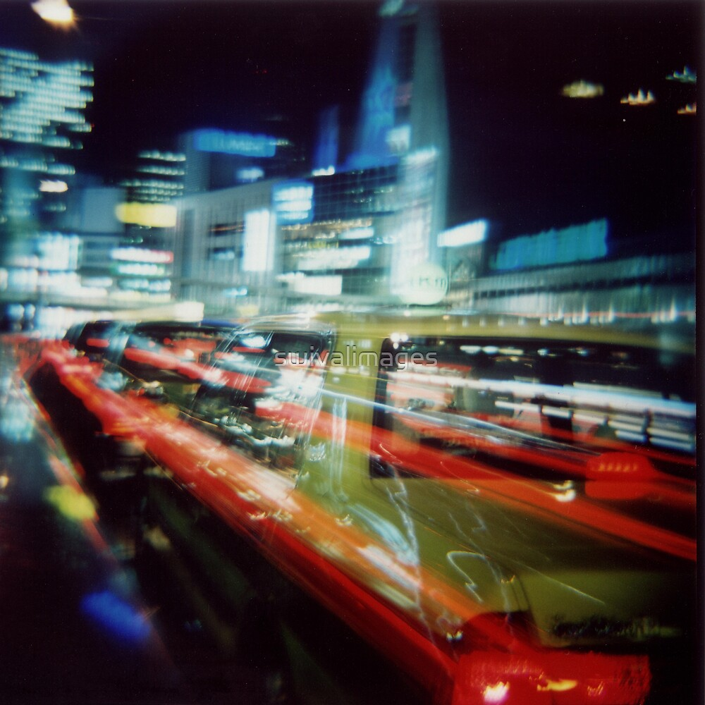 Shinjuku at Night by swivalimages