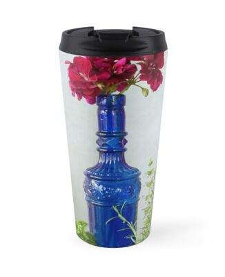 Blue glass bottle with vegetables and flowers by gameover