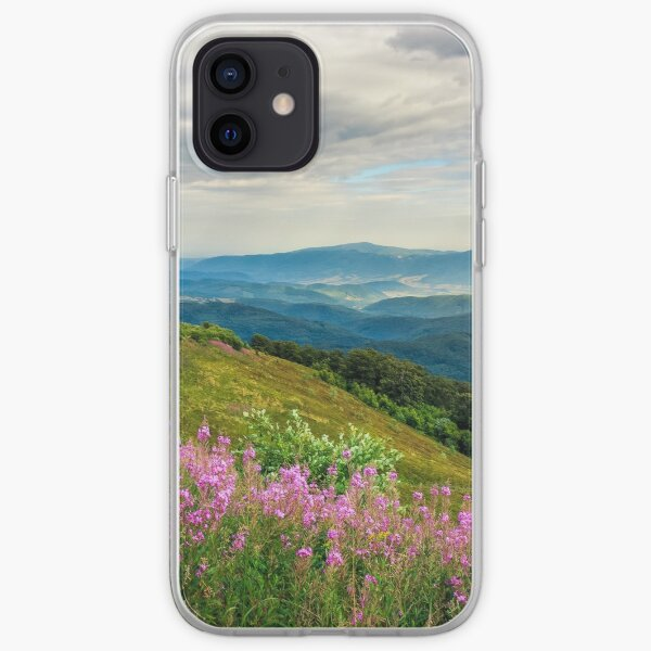 meadow with purple flowers in mountains iPhone Soft Case