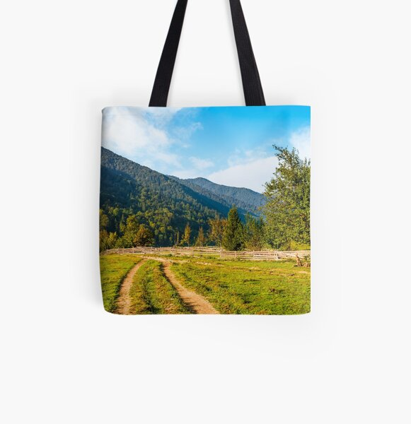 orchrd behind the fence in mountains All Over Print Tote Bag
