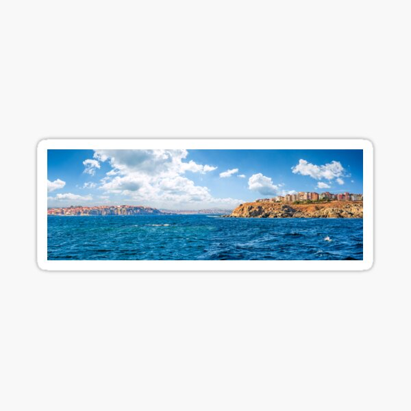 town on a cliff above the seashore Sticker