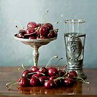 Cherries on silver plate and ancient glass by gameover