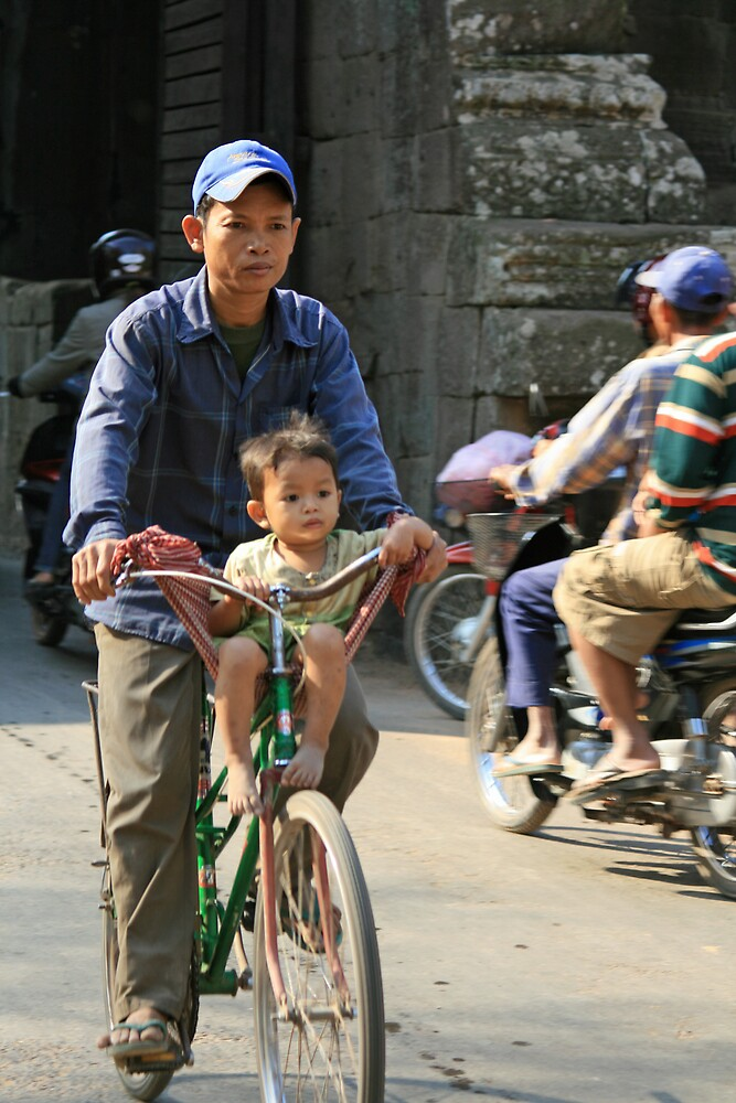 Baby on a bike near Bayon, Cambodia by Leigh Penfold