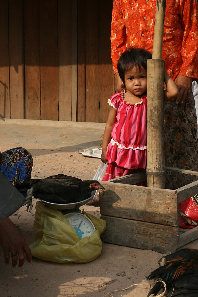 Shy girl at markets, Cambodia by Leigh Penfold