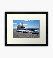 Boats on a beach Framed Print