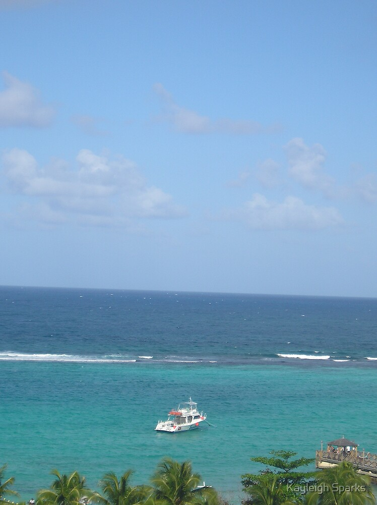 Boat in the Jamaican sea by Kayleigh Sparks