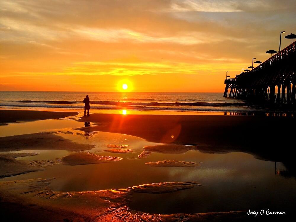Photographer At Sunrise Near Pier by Joey O'Connor