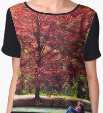 Autumnal romance, lovers embracing under red leaves Women's Chiffon Top