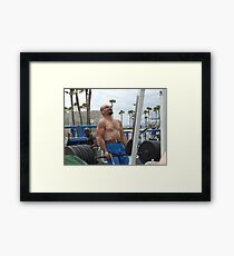 The Struggling Beefcake Framed Print