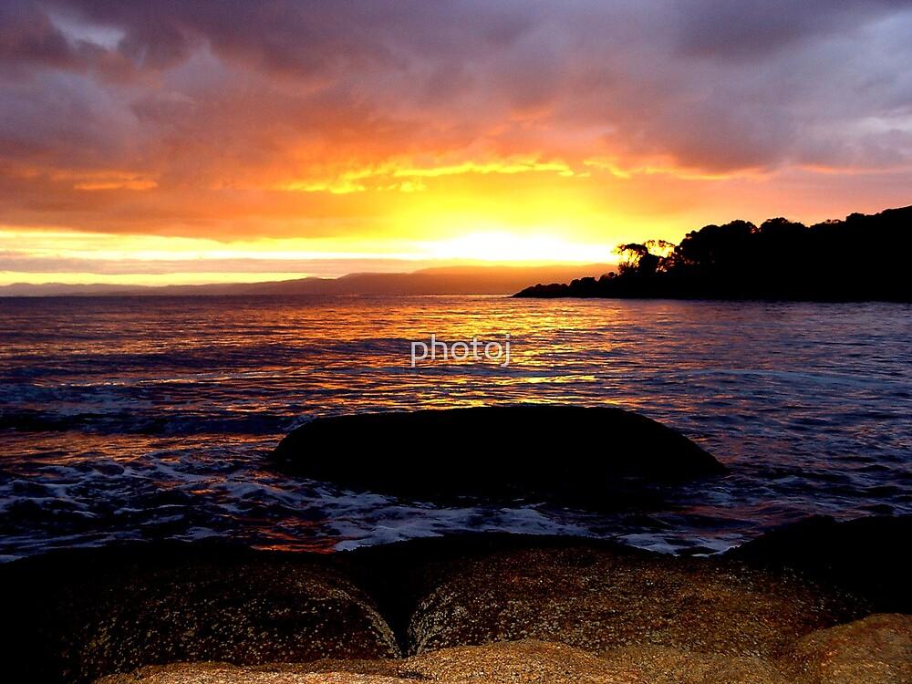 photoj sunset over the sea by photoj