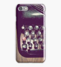 Typewriter on hardwood floor iPhone Case/Skin