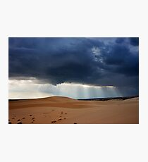 Storm clouds with piercing sunrays covering desert landscape. Photographic Print