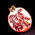 Pomegranate to share? by frccle