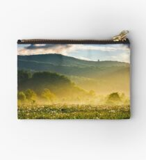 dandelion field at foggy sunrise in mountains Studio Pouch