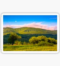 moonrise over the mountain in rural area at sunset Sticker