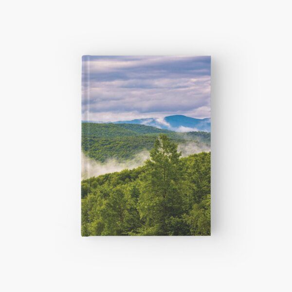 foggy mountain ridge over the forest in springtime Hardcover Journal
