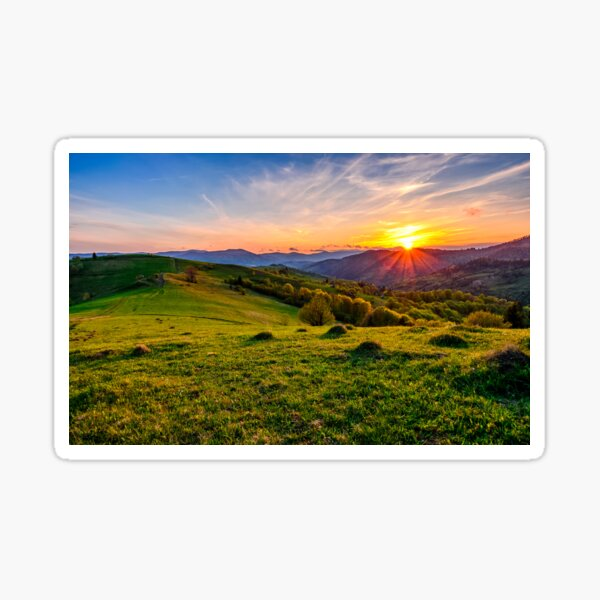 mountain rural area in springtime at cloudy sunset  Sticker