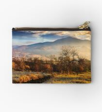 orchard on a hillside at foggy sunrise in mountains Studio Pouch