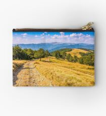 Countryside road in mountains at sunset Studio Pouch