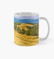 Countryside road in mountains at sunset Mug