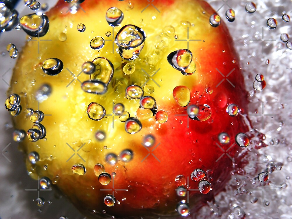 Water droplets on an apple by Andrea Austin