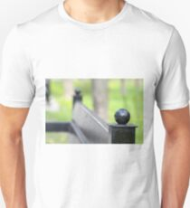 Blurred view of park bench and green lawn Unisex T-Shirt