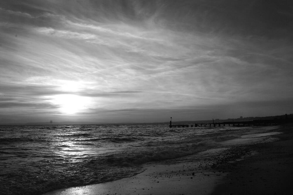 Winter sunset on the beach by Katie Allen