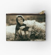 Cute girl with flowers field Studio Pouch