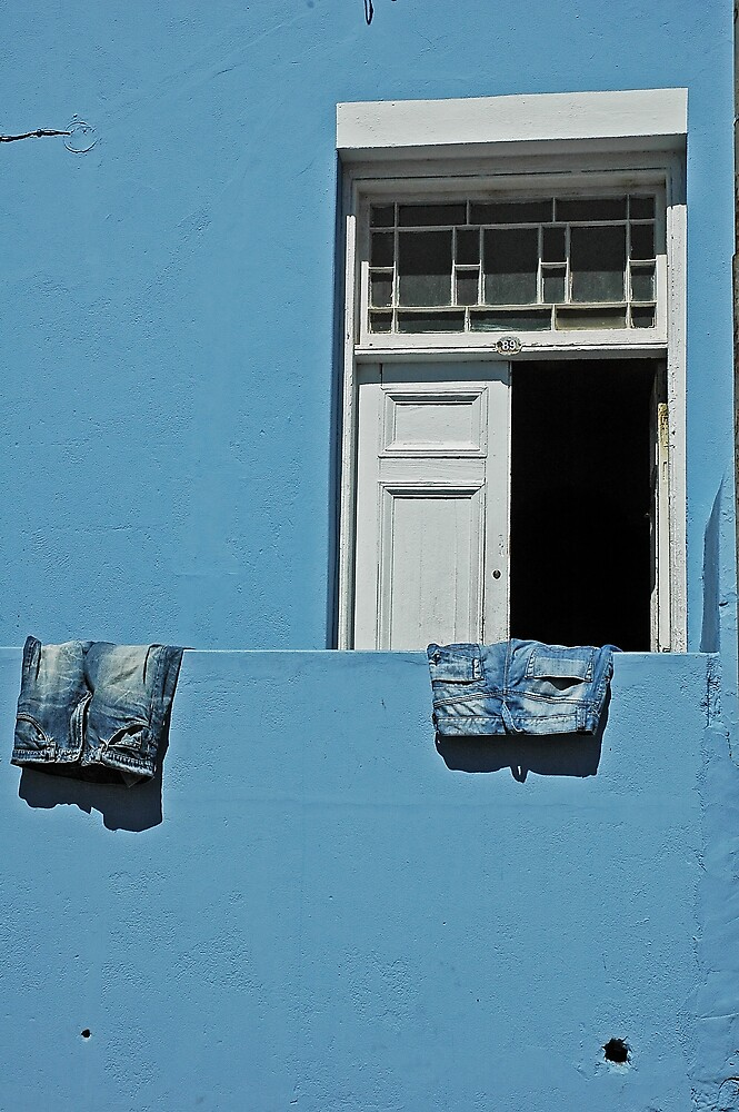 blue jeans on a blue wall by Kate Wilhelm