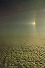 Sundog with a partially visible section of a 22 degree Halo over Antarctica.... by Juilee  Pryor