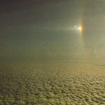 Sundog with a partially visible section of a 22 degree Halo over Antarctica.... by JuileeP