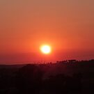 A Large Red Ball comes over the Hill! Sunrise Mt. Pleasant!  by Rita Blom