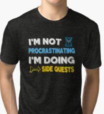 I'm not procrastinating... I'm doing side quests Tri-blend T-Shirt